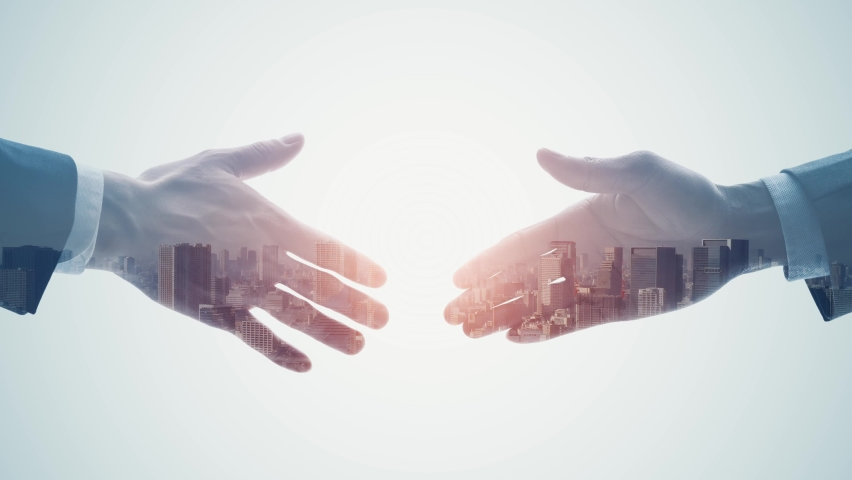 Silhouette of men shaking hands and modern cityscape. Double exposure. Royalty-Free Stock Footage #1068015080