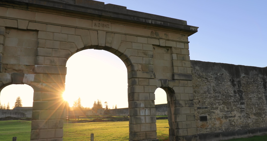 Locked off stationary motion of brick walls and ruins of the Penal Colony prison at kingston at morning sunrise, Mostly just surrounding walls remain, Kingston, Norfolk Island,Australia | Shutterstock HD Video #1068072101