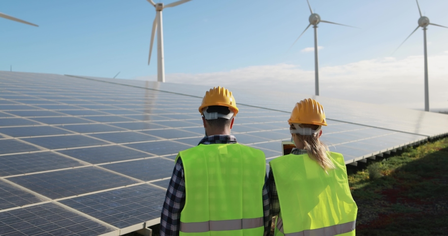 Young working people at renewable energy farm | Shutterstock HD Video #1068072461