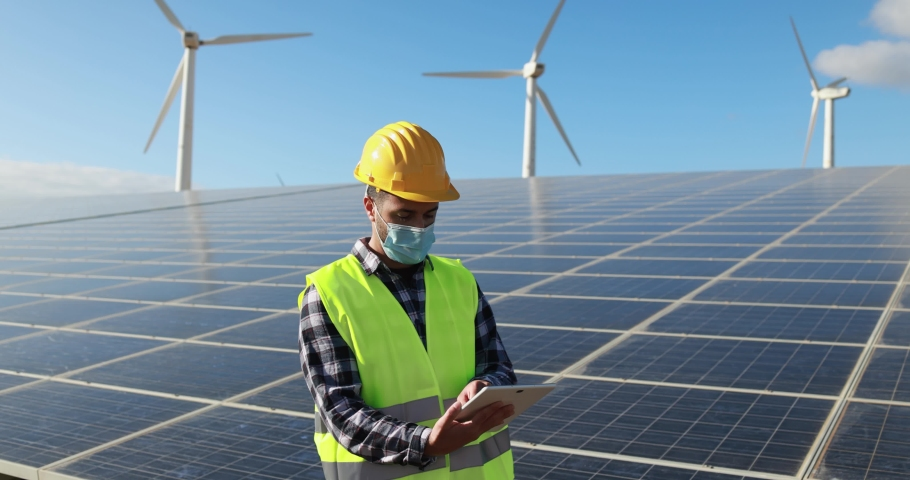 Worker man with digital tablet  wearing safety mask inside wind farm - Ecology and renewable energies concept | Shutterstock HD Video #1068072488