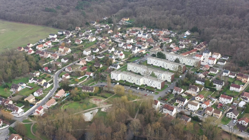 Saint-Chéron, France - February 2021 : french village where a 14 year old college girl was stabbed to death on Monday February 22. Drone aerial view above Mirgaudon HLM social housing.
