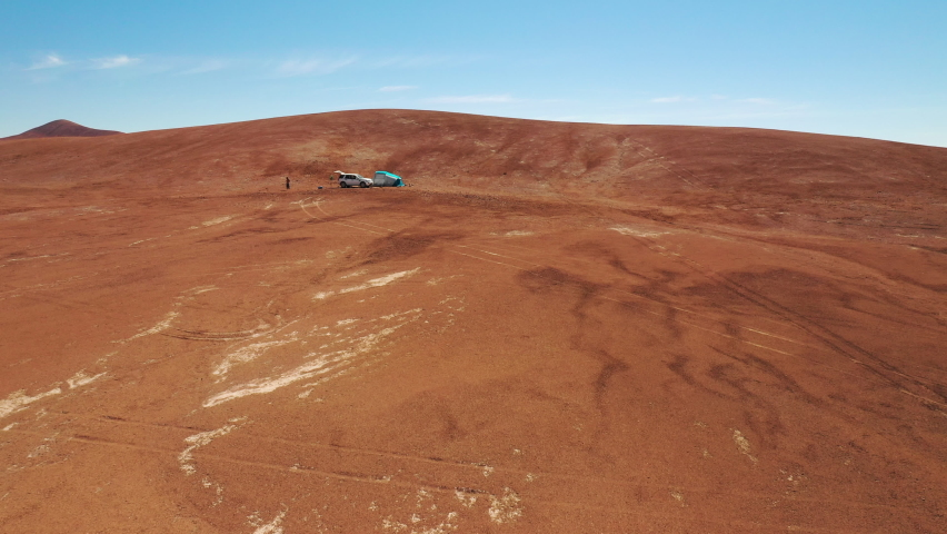 Aerial view Campsite at Atacama Desert an amazing road trip along the driest desert in the world with a 4x4 truck and a tent mounted on the campsite and still the views of the car track. An awe scenic | Shutterstock HD Video #1068114161