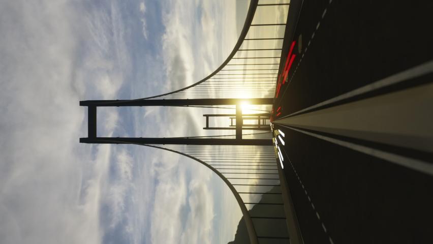Forward motion across the center of bridge with traffic speeding in both directions. Stunning sunshine with splendid skyline view on background. Hyperlapse animation. Vertical format | Shutterstock HD Video #1068118514