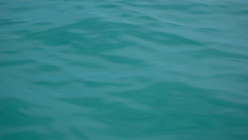 Blue water of sea as seen from moving on waves catamaran | Shutterstock HD Video #1068123440