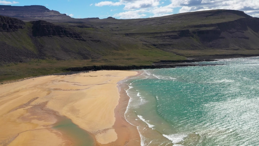 Flying  over beautiful beach with tuquoise sea waves. West fjords of Iceland. Raudasandur - yellow sand beach | Shutterstock HD Video #1068124451
