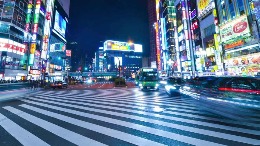 Jan1,2020:Shinjuku,Tokyo,Japan: Time-lapse of crowded people crossing road,car traffic at Kabukicho at Shinjuku Tokyo.Japan's entertainment night life.Tokyo famous tourist attraction.Tokyo Olympic2020