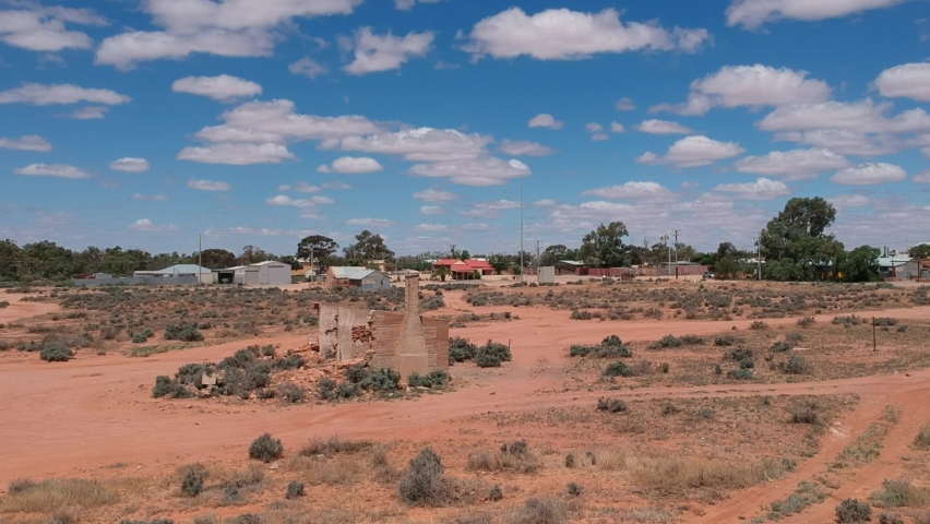 Flying over abandoned building near Silverton in outback Australia