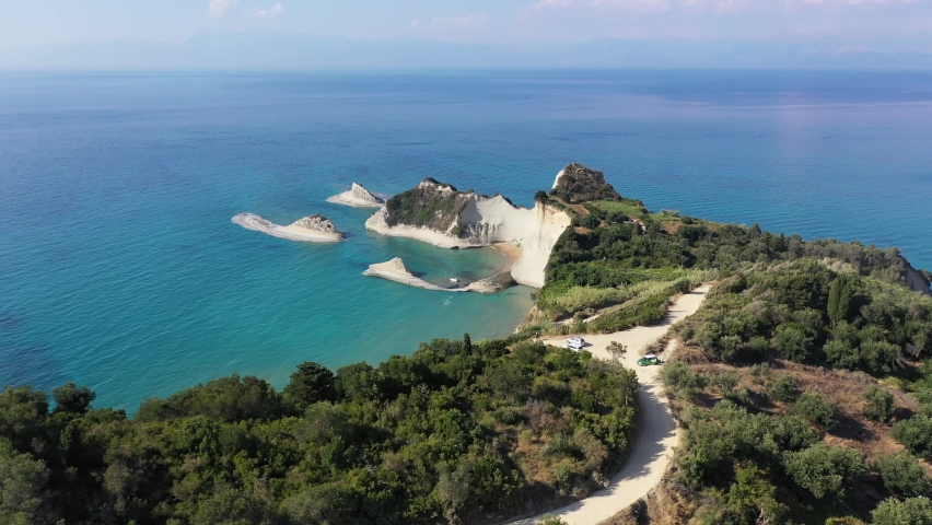 Cape Drastis, Corfu, Greece. Aerial view of peninsula in Corfu featuring small beaches and cliffs.   Shutterstock HD Video #1068321305