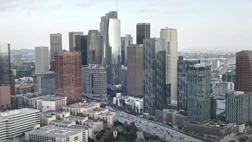LOS ANGELES, CA, USA - Feb 15, 2021: Drone 4k. Aerial view of downtown Los Angeles. Establishing shot of LA. Modern urban life, financial business center, office skyscrapers, banks, city in USA.