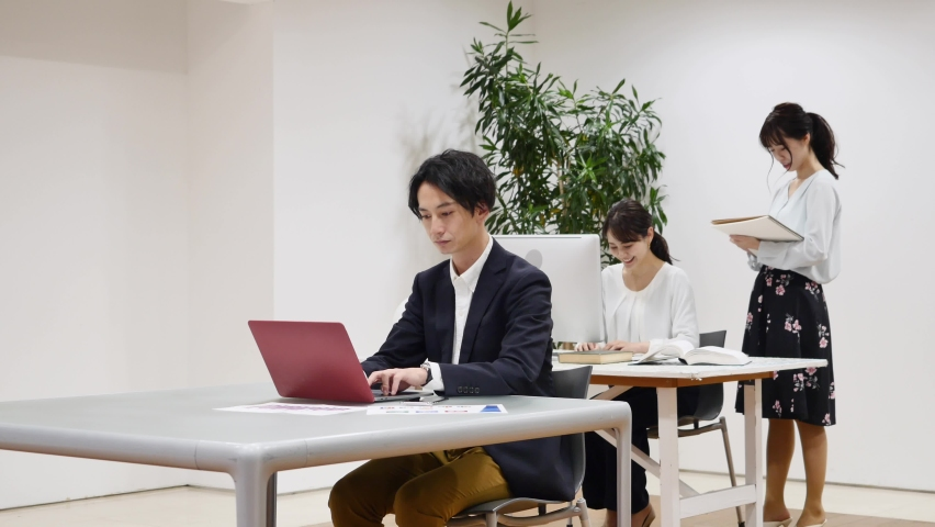 Asian office workers working at the office Royalty-Free Stock Footage #1068351728
