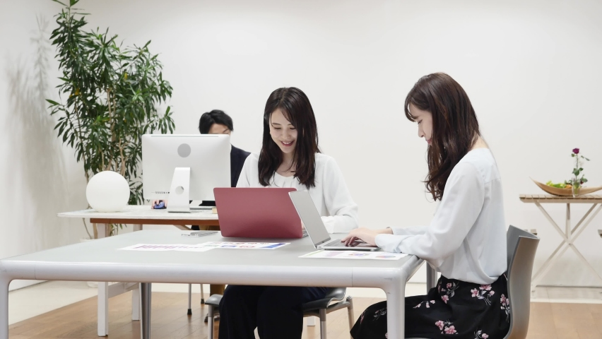 Asian office workers working at the office Royalty-Free Stock Footage #1068351743