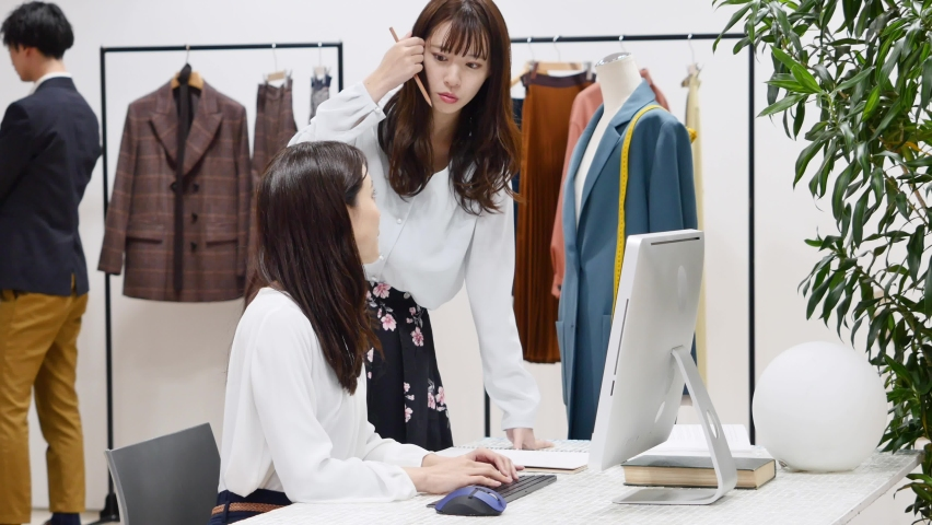 Asian fashion designers working at the office Royalty-Free Stock Footage #1068351749