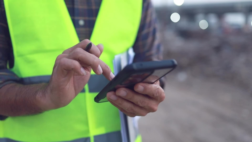 engineer working using smartphone at the construction site Royalty-Free Stock Footage #1068452228