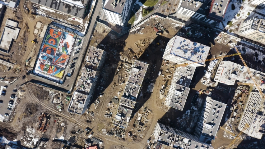 Fly over the construction site, work as construction personnel, builders work, construction houses. Aerial Flight Over a New Constructions Development Site with High Tower Cranes Building Real Estate.   Shutterstock HD Video #1068469703
