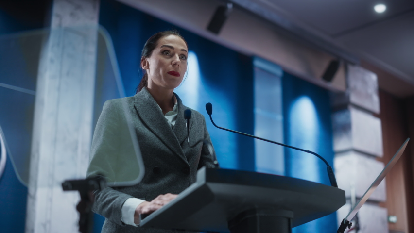 Portrait of Organization Female Representative Speaking at Press Conference in Government Building. Press Office Representative Delivering a Speech at Summit. Minister Speaking to Congress Hearing. Royalty-Free Stock Footage #1068497825