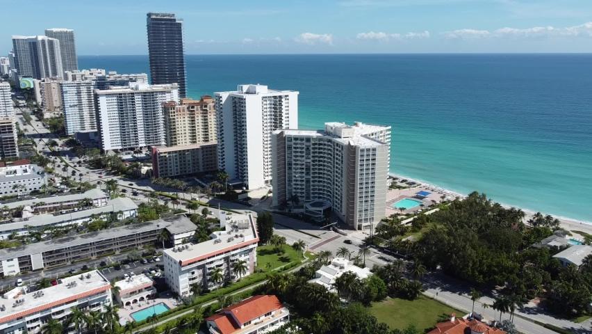 Skyline of Hallandale Beach Florida showing condos and the Atlantic Ocean.    Shutterstock HD Video #1068510785