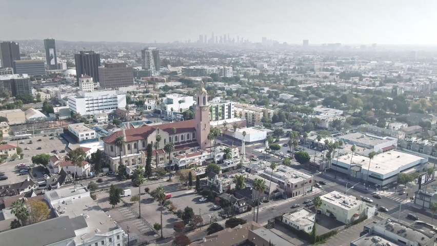 LOS ANGELES, CA, USA - Feb 15, 2021: Drone aerial shot 4k. Hollywood neighborhood with views of downtown Los Angeles. office skyscrapers buildings in LA center. Smog air pollution smog due to cars
