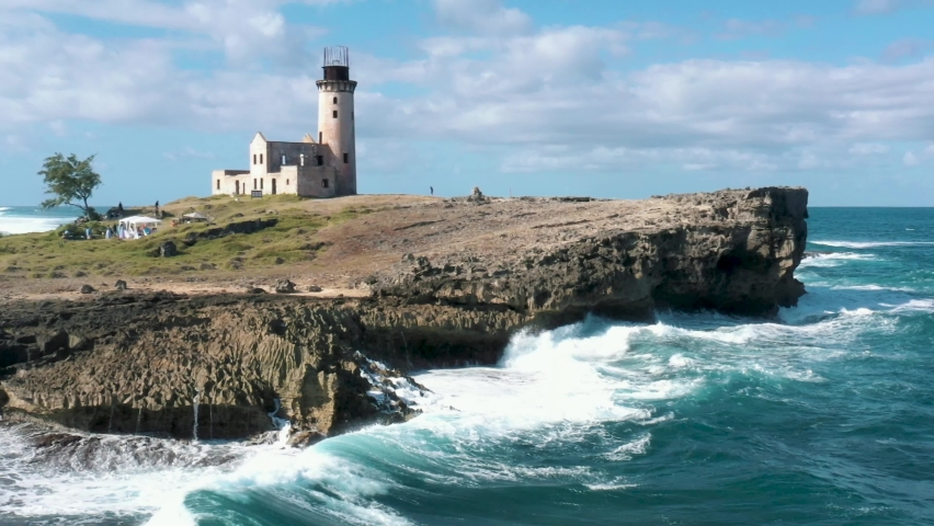 Large ocean waves crashing in towards cliff face on Fouquets Island. Aerial wide shot of island with abandoned lighthouse.   Shutterstock HD Video #1068618794