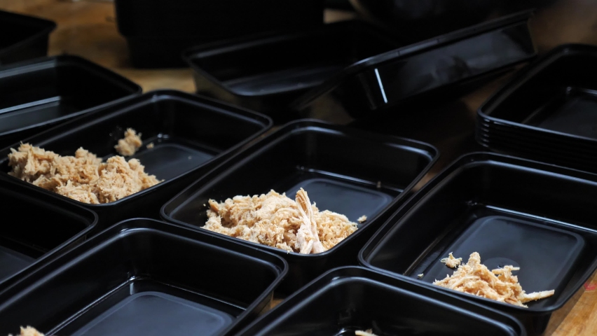 Packing Shredded Chicken Meat Meals in a Plastic Boxes for Takeaway or Delivery. Food Industry During Covid-19 Pandemic and Lockdown, Slow Motion Close Up   Shutterstock HD Video #1068619409