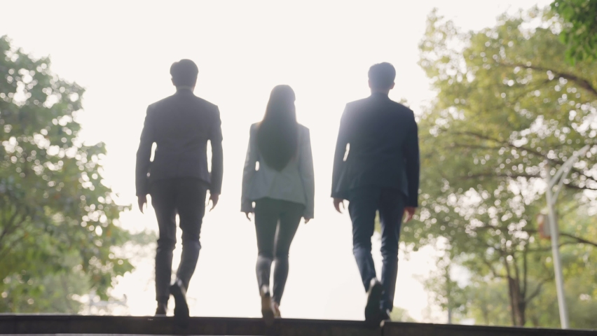 Rear view of a team of asian business people ascending stairs | Shutterstock HD Video #1068682739