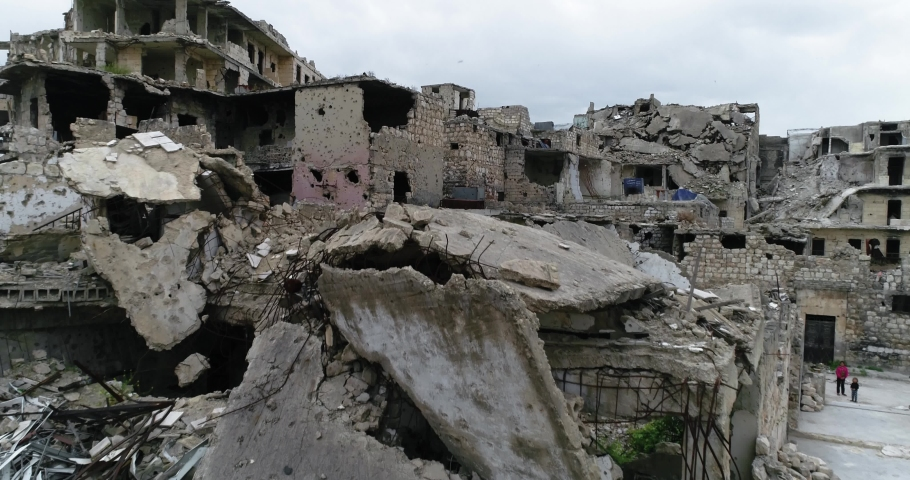 Drone flying over ruins of buildings in Aleppo, Syria. We can see destroyed buildings in the street of the city 4K