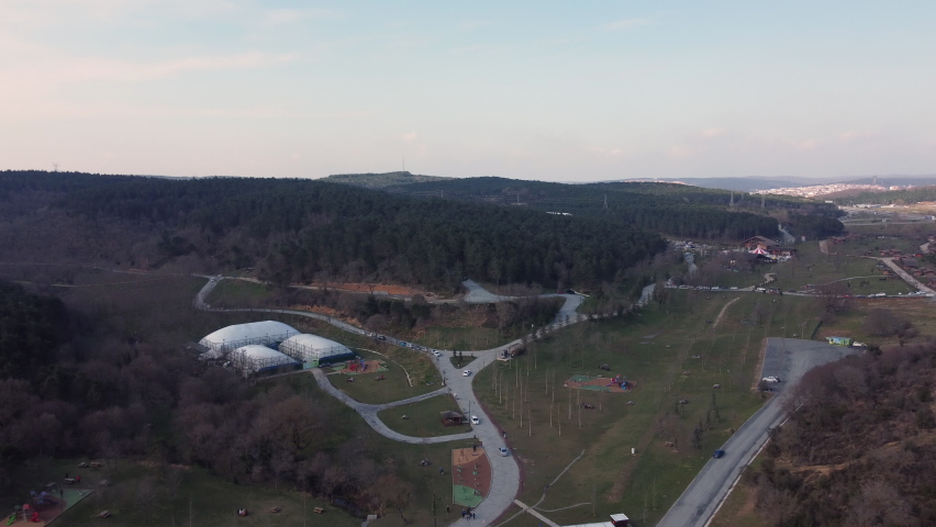 Aerial view of recreational facilities, indoor tennis courts in the city forest and parking lot in Kemerburgaz, Istanbul Royalty-Free Stock Footage #1068721331