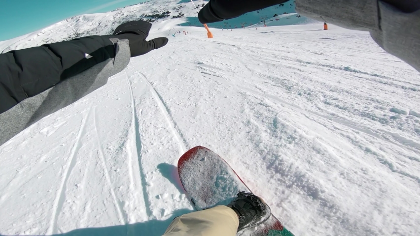 First Person POV of Person Snowboarding Fast on Ski Slope Mountain | Shutterstock HD Video #1068753407