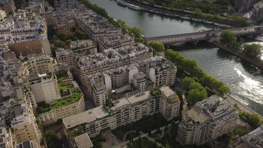sunny evening flight over paris city riverside famous tower square bay aerial panorama 4k france Royalty-Free Stock Footage #1068803264