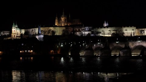 zooming to Charles bridge and Prague castle and St. Vitus temple at night in Prague