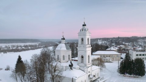 Aerial view of russian winter countryside Tarusa. Flying over village, Orthodox church, River, Snow