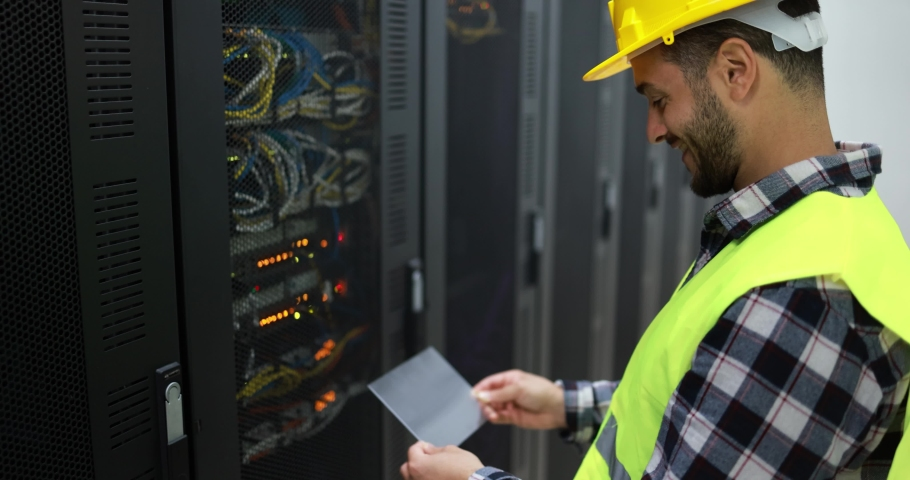 Young technician man at work installing a new rack mount server inside server room Royalty-Free Stock Footage #1069004077