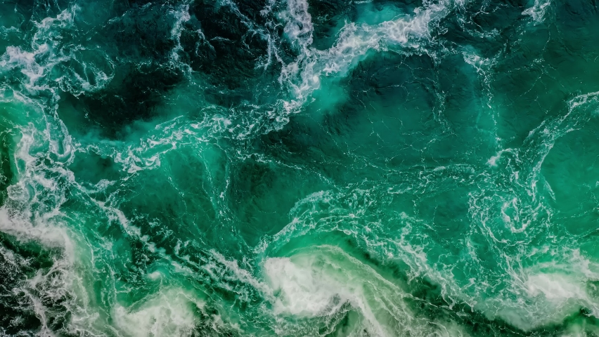 Waves of water of the river and the sea meet each other during high tide and low tide. Whirlpools of the maelstrom of Saltstraumen, Nordland, Norway Royalty-Free Stock Footage #1069019194