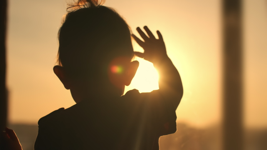 Sun Flare, Change the Future, Kid Dream, Kids Celebration, Holiday Bye, Up Hold, Night Party, Line Sunrise, Behind Sunshine, Entertainment. Anxious child knocks his hand on the window during sunset Royalty-Free Stock Footage #1069023463