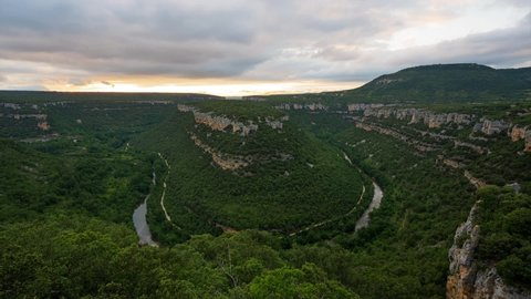 Scenic time lapse of a deep canyon of Ebro river at sunset, in Burgos, Castile