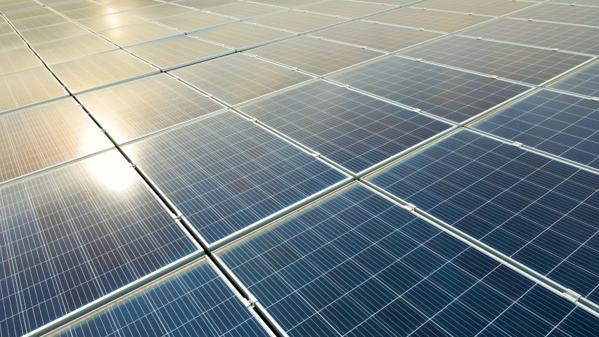 Closeup of surface of blue photovoltaic solar panels mounted on building roof for producing clean ecological electricity. Production of renewable energy concept. Royalty-Free Stock Footage #1069060555