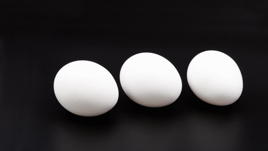 White chicken eggs. Close-up. On a black background. | Shutterstock HD Video #1069111783