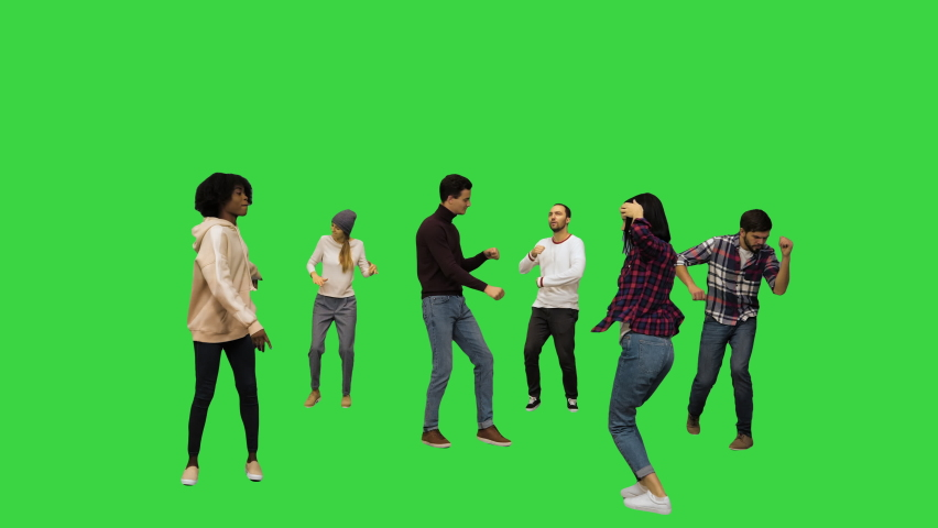 Wide shot. Front view. Flashmob: young people walk in and start dancing on a Green Screen, Chroma Key. Professional shot in 4K resolution. 042. You can use it e.g. in your medical, commercial video,