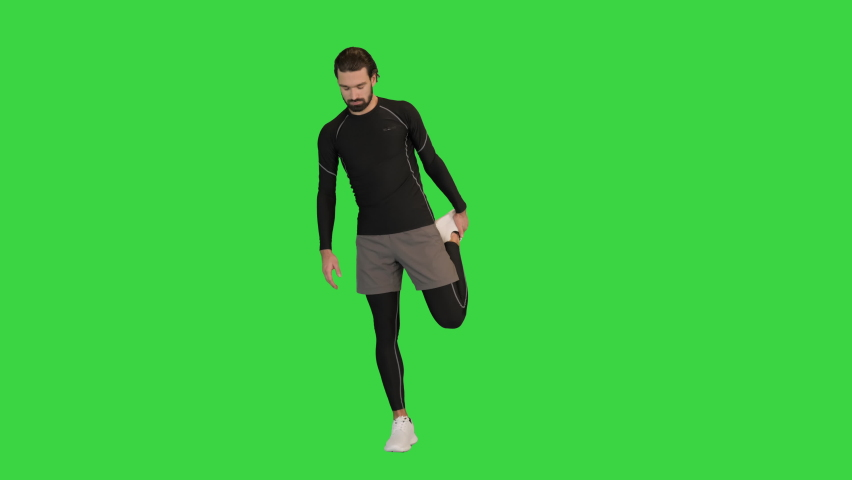 Wide shot. Front view. Fitness man doing warm up exercises on a Green Screen, Chroma Key. Professional shot in 4K resolution. 068. You can use it e.g. in your medical, commercial video, business,