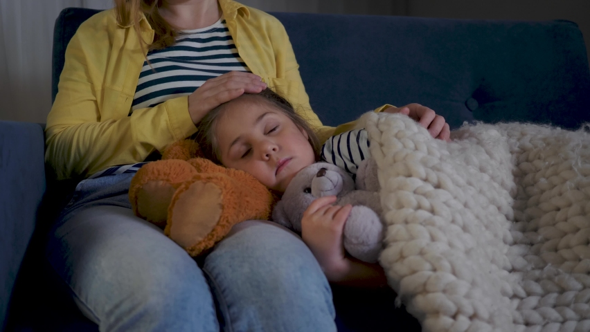 Sleeping baby with mom. Happy family. Baby girl sleeping with teddy bear toy. Mom waits for her daughter. Happy baby sleeping with toy teddy bear. Happy family taking care of children. Royalty-Free Stock Footage #1069203142