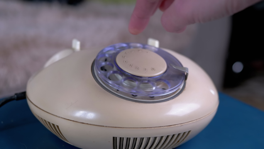 Female Hand Picks Up Phone and Dials Number on Vintage Retro Rotary Telephone Royalty-Free Stock Footage #1069203976