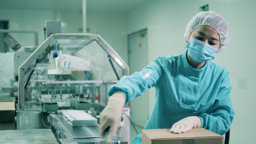 Female health worker packing medicines. Drugs production, pharmacist working, pharmaceutical manufacturing, pharmaceutical industry concept. Royalty-Free Stock Footage #1069303324