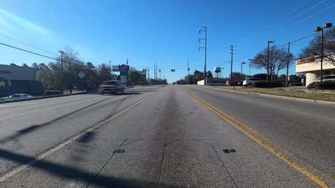 Columbia County, Ga USA - 03 19 21: Rear POV view of traffic coming and going Belair road