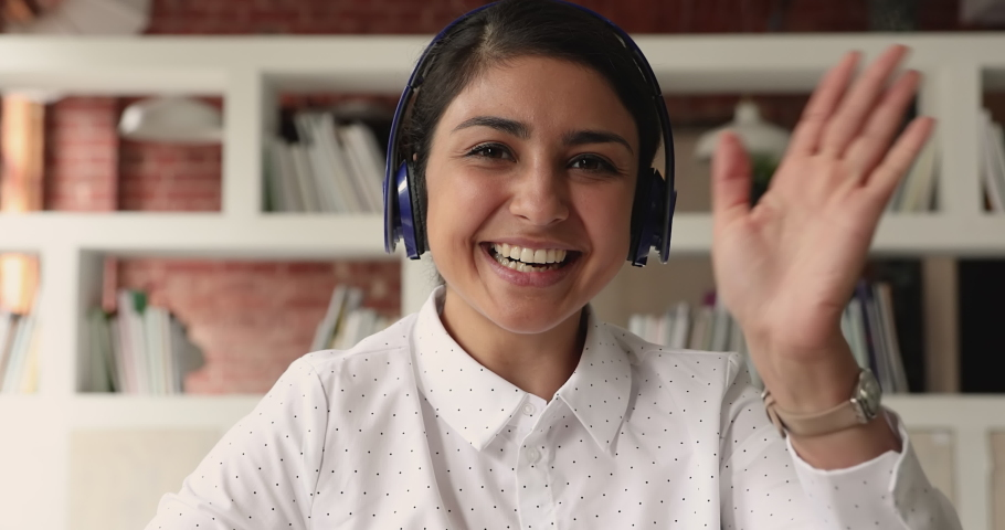 Close up webcam view attractive smiling Indian woman applicant pass job interview remotely by video call. Student participates in educational webinar sitting in library. Virtual event meeting concept Royalty-Free Stock Footage #1069357228