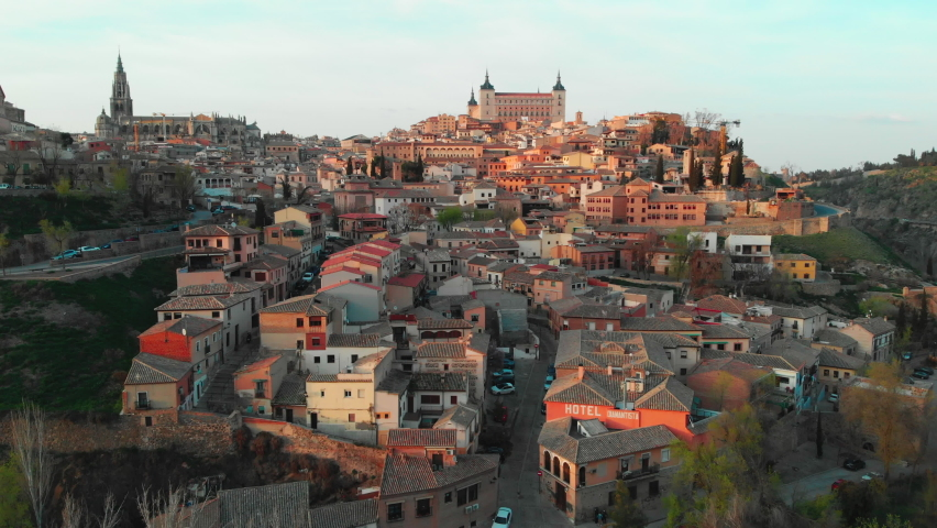 Toledo, Spain - March 20, 2021: Aerial drone point of view historical city of Toledo. Castilla–La Mancha. Travel and tourism, famous tourist attraction place concept. Spain. Europe