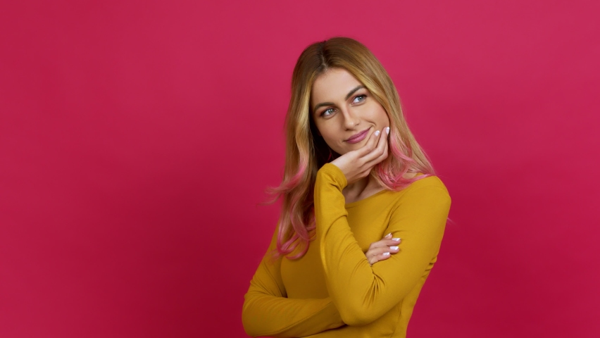 Young blonde woman keeping the arms crossed in confident expression over isolated background | Shutterstock HD Video #1069361053