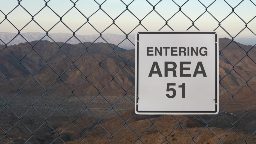 Entering Area 51 Sign On A Fence At The Military Base In The Nevada Desert At Sunset   Shutterstock HD Video #1069364671