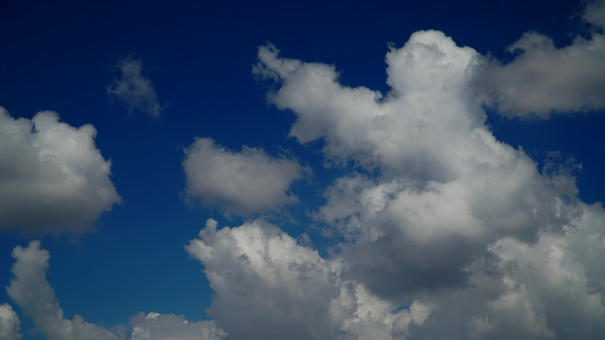 White clouds. Blue sky. Puffy fluffy white clouds. Cumulus cloudscape timelapse. Summer blue sky time lapse. Nature weather blue sky. White clouds background. Cloud time lapse nature background  Royalty-Free Stock Footage #1069429012