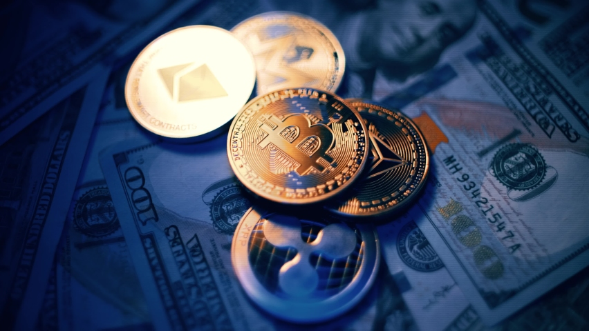 Bitcoin BTC coin and Ethereum ETH coins are rotating on bills of 100 dollars. Digital coin cyberspace and cryptocurrency. Concept of exchange market and online payment. Royalty-Free Stock Footage #1069464211