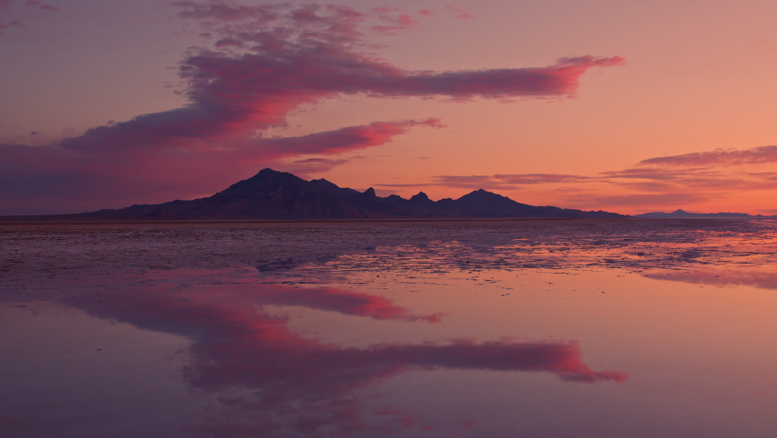 Timelapse of colorful sunrise over the Great Salt Lake as water covers the Bonneville Salt Flats in Utah.