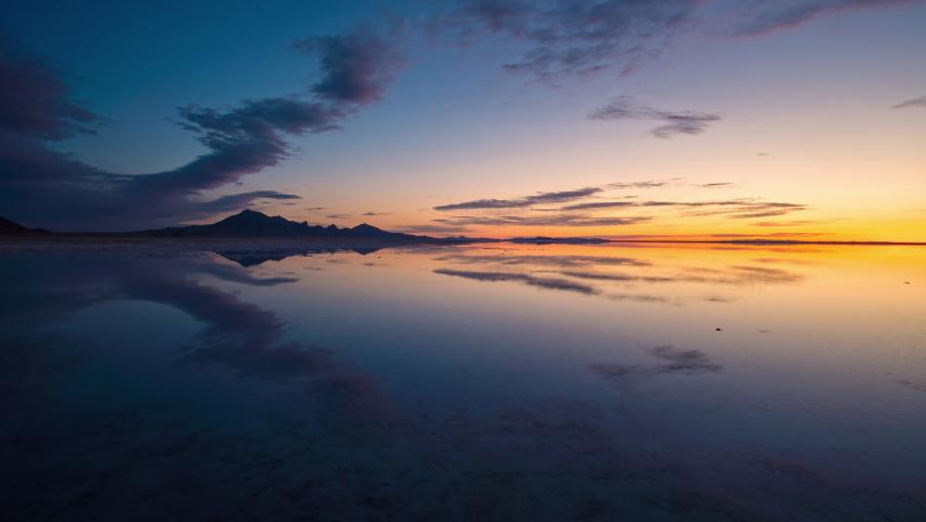 Colorful timelapse over the Great Salt Lake covering the Bonneville Salt Flats at sunrise in Utah.